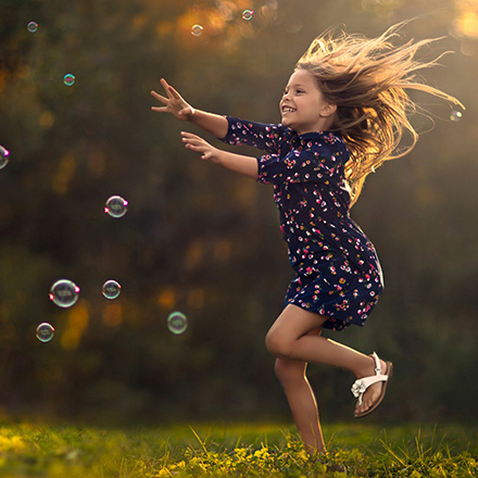 A girl jumping on a meadow